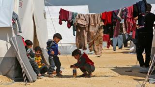 Children play at a camp for displaced Syrians in al-Bil