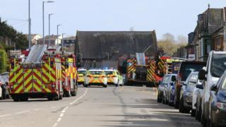Emergency service vehicles at the scene of the crash