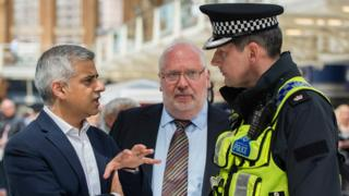 Mayor of London Sadiq Khan and Lord Harris during a routine operation with British Transport Police officers