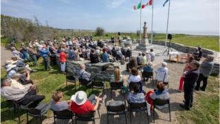 The burial service of 21 Irish people who died fleeing the famine 172 years ago.