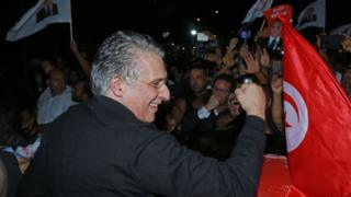 Nabil Karoui greets his supporters after being released from Mornaguia prison near the capital Tunis on 9 October