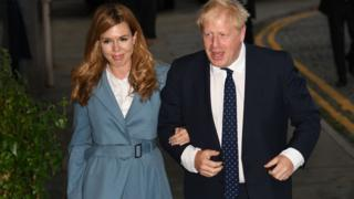 Boris Johnson and his partner Carrie Symonds arrive in Manchester