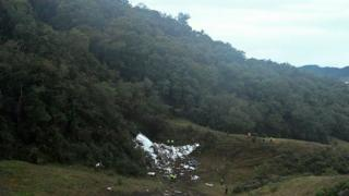 The wreckage of the Lamia airlines charter plane carrying members of the Chapecoense Real football team that crashed is seen in the mountains of Cerro Gordo, municipality of La Union, on 29 November