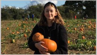 Eliza Hunt with her pumpkins