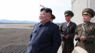 Kim Jong-un watches flight training with military personnel supporting him on April 16th.