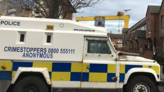 Police are carrying out searches on the Newtownards Road in east Belfast