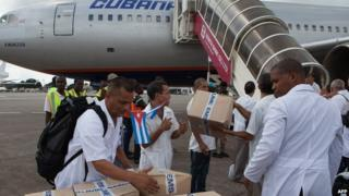 The first members of a team of 165 Cuban doctors and health workers upon their arrival at Freetown's airport to help the fight against Ebola in Sierra Leone, on 2 October, 2014.