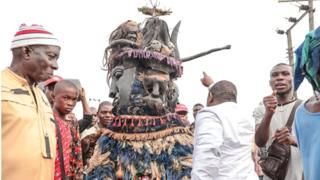 Man in a masquerade costume in Arondizuogu during the Ikeji Festival in Nigeria