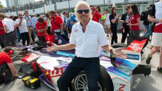Richard Branson with a Formula E car