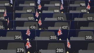 UK flags on desks in the European Parliament