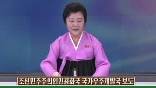 A North Korean newscaster making an announcement about North Korea's satellite launch