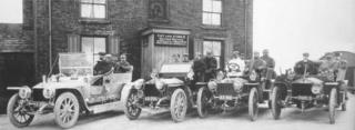 Gathering of motor cars outside Cat & Fiddle in June 1907