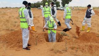 Six Libyan experts search for human remains during the exhumation of mass graves in Tarhuna, south-east of Tripoli, Libya -23 June 2020