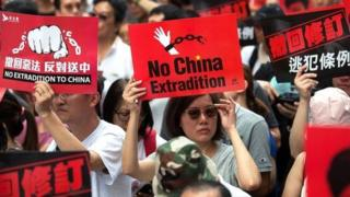 Thousands of protesters take part in a march against amendments to an extradition bill in Hong Kong, China, on 9 June 2019