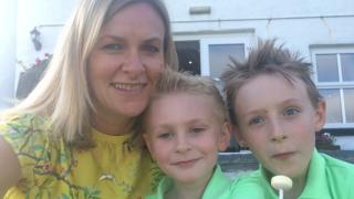 Kerry McAuley and her sons