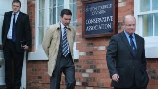 Chris Jones (left), Stuart Hinton (centre) and Ken Mackaill (right) are seen leaving the meeting with Mr Mitchell