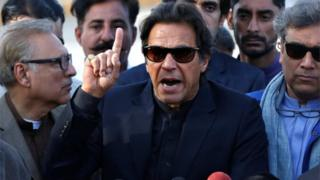 Imran Khan, chairman of the Pakistan Tehreek-e-Insaf (PTI) political party, gestures as he addresses members of the media, after Pakistan's Supreme Court dismissed a petition to disqualify him from parliament for not declaring assets, outside Jinnah International Airport in Karachi, Pakistan December 15, 2017.
