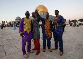 Kenyan men take a selfie outside the Dome of the Rock in Jerusalem, Israel - Monday 12 September 2016