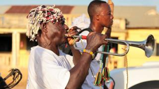 A man blows a trumpet during the Aboakyer festival, in Winneba, Ghana.