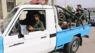 Police patrol a street in the Red Sea port city of Hudaydah (13 February 2019)