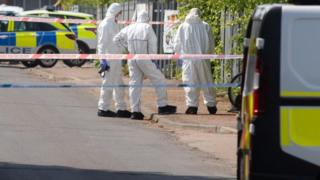 Forensic officers at scene of sudden death