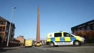 Police vehicles parked near Dixons Chimney