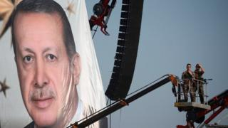 A giant portrait of Turkish President Recep Tayyip Erdogan at a rally in Istanbul, 7 August