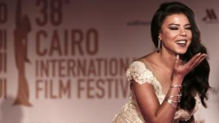 Egyptian actress Nahed El Sebai blows a kiss to photographers on the red carpet during the opening of the 38th Cairo International Film Festival at the Opera House in Egypt, Tuesday,15 November 2016