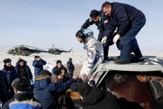 in_pictures NASA astronaut Christina Koch is helped shortly after the landing of the Russian Soyuz MS-13 space capsule