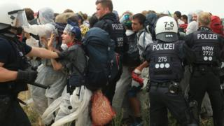 Police attempting to stop the activists from entering the mine