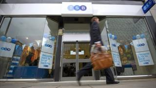 A customer walks past a TSB branch