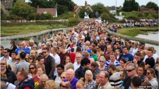 Mourners on a bridge in Shoreham during the minutes silence