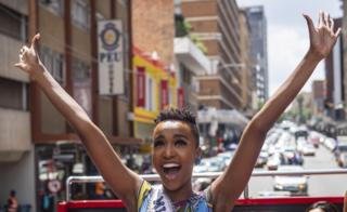 Miss Universe Zozibini Tunzi waving aboard an open-topped bus in Johannesburg, South Africa - Thursday 13 February 2020