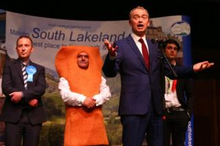 Leader of the Liberal democrats Tim Farron celebrates beating Conservative party candidate James Airey (L) Independent candidate Mr Fishfinger and Labour candidate Eli Aldridge (R) following the announcement of the results at the Westmoorland and Lonsdale constituency count at Kendal Leisure Centre on June 9, 2017 in Kendal,