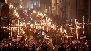 Bonfire societies parade through the streets