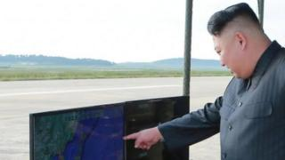 Kim Jong-un at the test of a Hwasong-12 missile, undated KCNA photo released on 16 September 2017