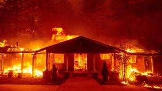 a home burns during the Camp fire in Paradise, California on November 8, 2018