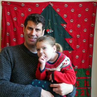 The author and his daughter in front of the advent calendar