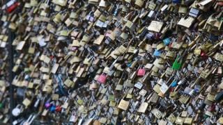 Padlocks on bridge