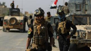 Iraqi forces are seen on 4 November, 2017 in the centre of the city of al-Qaim, in Iraq's western Anbar province after retaking it from Islamic State (IS) group jihadists a day earlier