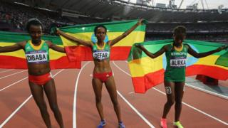 Ethiopian athletes celebrate after winning gold in the Women's 5000m Final at London 2012 Olympic Games