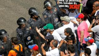 Opposition supporters face off with police during a rally against Venezuelan President Nicolas Maduro's government in Caracas, March 9, 2019