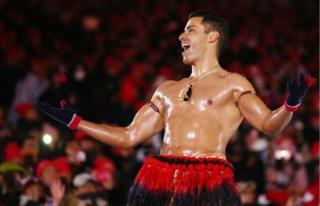 Pita Taufatofua of Tonga stands shirtless