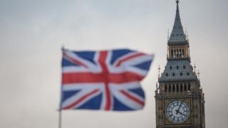 A Union flag flutters in front of the Elizabeth Tower, commonly known as Big Ben