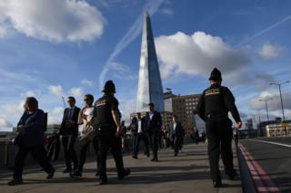 Police officer walking across London Bridge