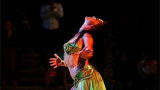 Belly dancer Julia Anderson of Britain performs for an audience at El Ain El Sokhna Resorts in Suez, east of Cairo, Egypt May 7, 2018.