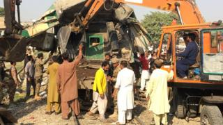 Diggers used on mangled wreck of train carriage - 3 November