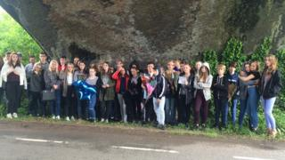 Teenagers gather at the scene