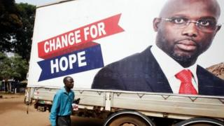 Election poster for George Weah in Monrovia, Liberia December 27, 2017