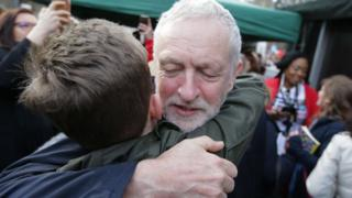 Corbyn hugs supporter